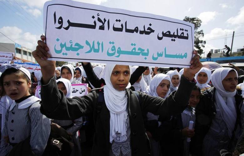 وقفة بغزة رفضاً لتقليص خدمات الأونروا