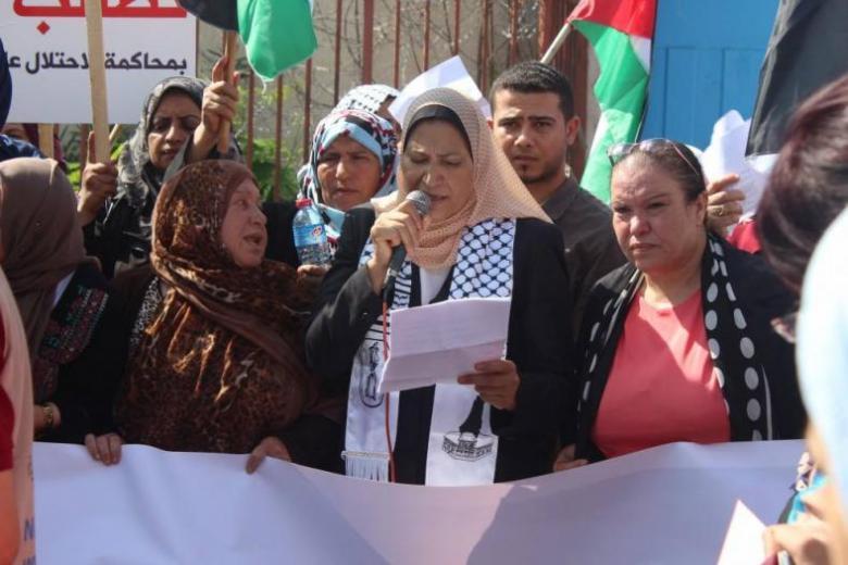 وقفة احتجاجية أمام مقر الأمم المتحدة بغزة رفضا لورشة المنامة