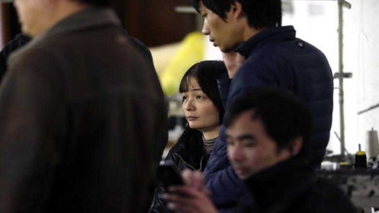 صينيون يحتجون على عدم دفع أجورهم