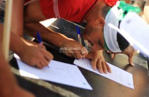 غزة تجمع آلاف التواقيع لدعم المصالحة