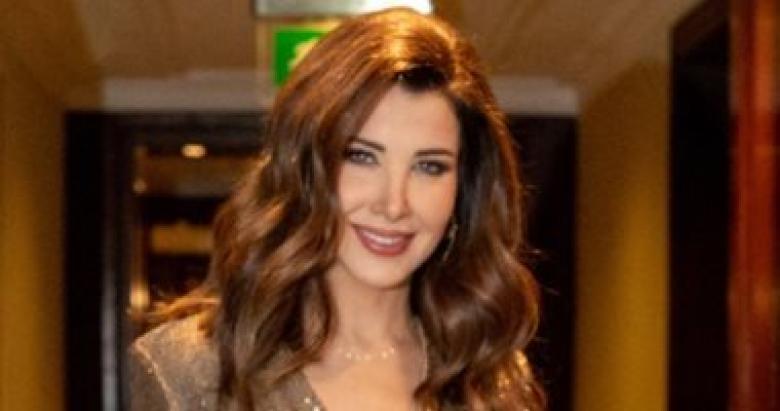 المسؤول الإعلامى لنانسى عجرم يوضح حقيقة صورتها وزوجها مع السارق
