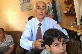 """تعرف على يوميات """"أقدم حلاق"""" في قطاع غزة"""
