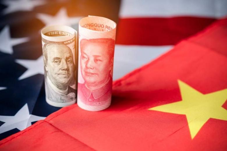 حرب العملات بين أميركا والصين.. سؤال وجواب