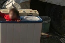 غسالة تنهي حياة طفلين توأمين بطريقة مريعة
