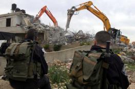 الاحتلال يهدم بناية من أربع شقق سكنية وطابق أرضي بالخليل