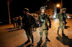 حملة اعتقالات ومداهمات في مدن الضفة والقدس