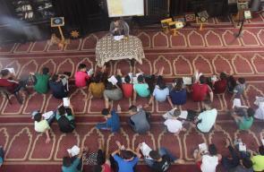 دار القرآن الكريم تواصل مخيماتها القرآنية بغزة