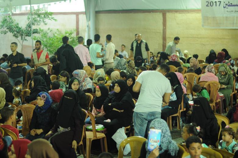 إفطار جماعي للأيتام بجامعة فلسطين في خانيونس