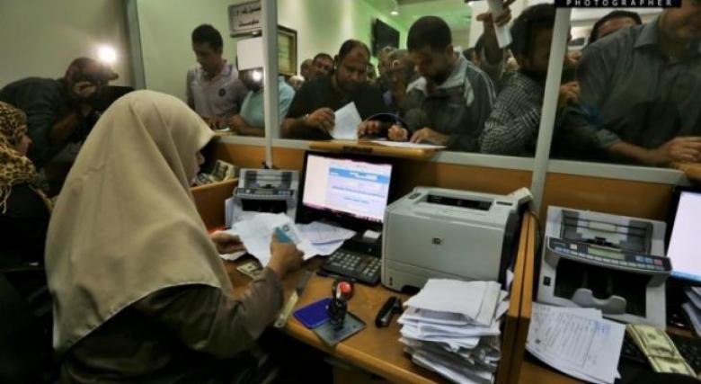 تفعيل نظام التسديد المحوسب للمعاملات الحكومية بغزة