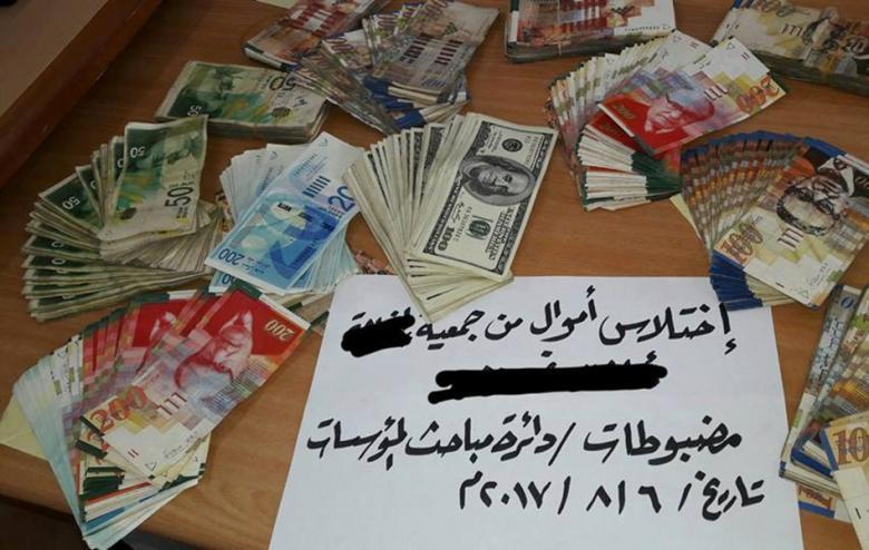 """المباحث تكشف """"اختلاس"""" 63 ألف دولار من مؤسسة بغزة"""