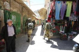 الاحتلال يجبر أصحاب المحلات في الخليل على إغلاقها