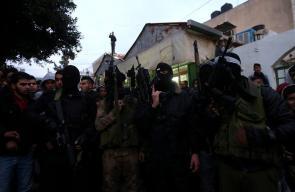 مسلحون خلال جنازة الشهيد محمد الصالحي