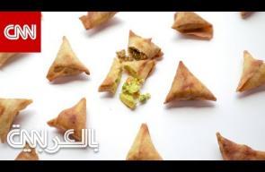 السمبوسة.. مثلثات ذهبية لا تفارق مائدة الإفطار .. فما أصلها؟