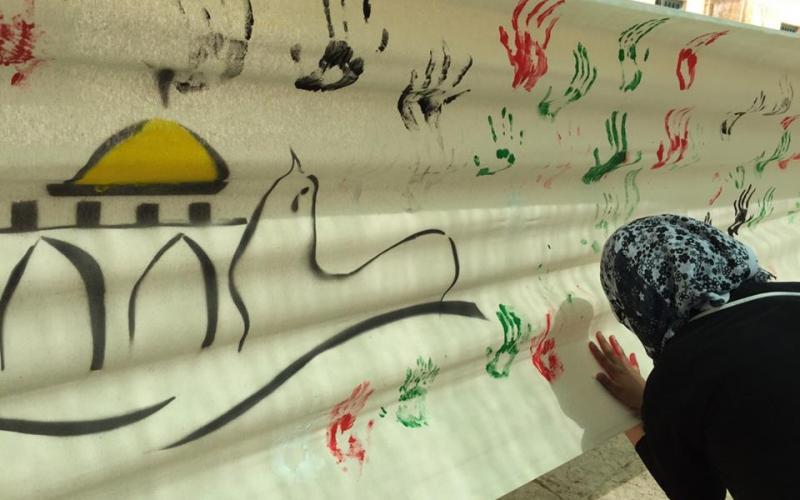 صور: رسم جدارية في الأقصى تحوي بصمة الأطفال | فلسطين الآن