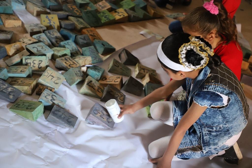 خانيونس: أطفال يجسدون جدارية فنية تحمل أسماء القرى الفلسطينية