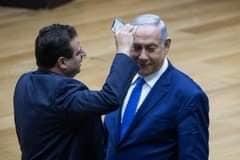 مشادّة بين نتنياهو ورئيس القائمة العربية بالكنيست